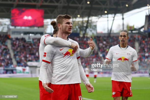Timo Werner of RB Leipzig celebrates with teammates after scoring his team's first goal during the Bundesliga match between RB Leipzig and VfL...