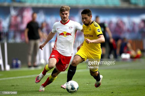 Timo Werner of RB Leipzig challenges Raphael Guerreiro of Borussia Dortmund during the Bundesliga match between RB Leipzig and Borussia Dortmund at...