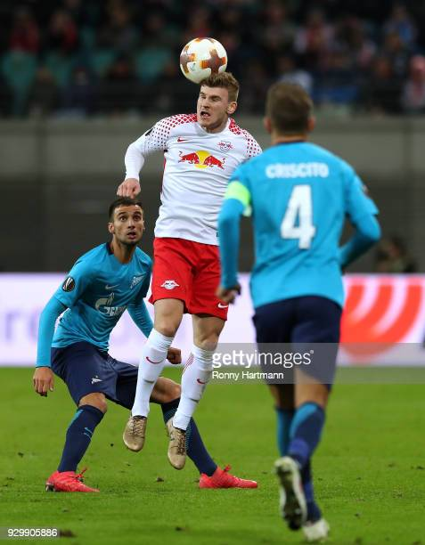 Timo Werner of RB Leipzig heads the ball next to Emanuel Mammana and Domenico Criscito of FC Zenit Saint Petersburg during the UEFA Europa League...