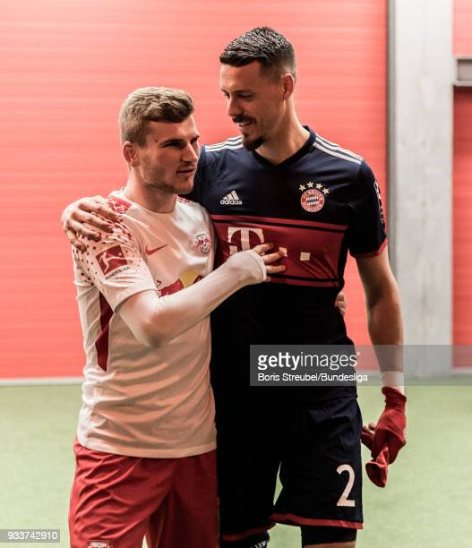 Timo Werner of RB Leipzig hugs Sandro Wagner of Bayern Muenchen in the players tunnel during the Bundesliga match between RB Leipzig and FC Bayern...