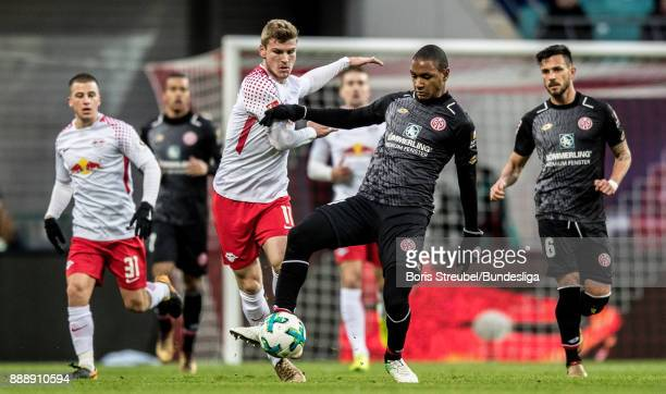 Timo Werner of RB Leipzig in action with Abdou Diallo of 1 FSV Mainz 05 during the Bundesliga match between RB Leipzig and 1 FSV Mainz 05 at Red Bull...