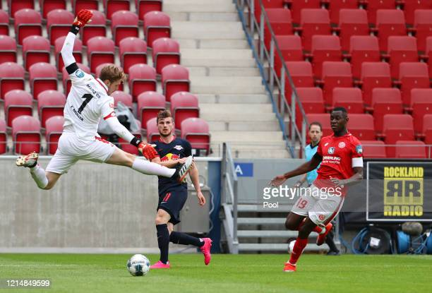 Timo Werner of RB Leipzig in action with Moussa Niakhate of Mainz during the Bundesliga match between 1. FSV Mainz 05 and RB Leipzig at Opel Arena on...