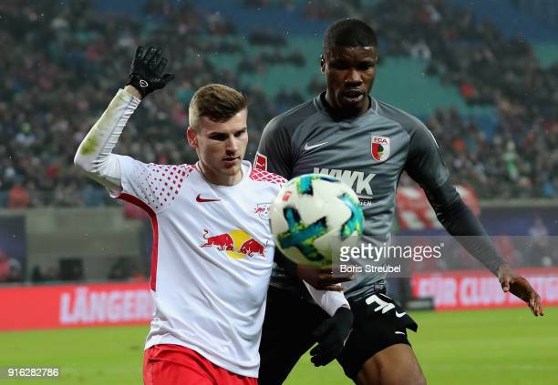 Timo Werner of RB Leipzig is challenged by Kevin Danso of FC Augsburg during the Bundesliga match between RB Leipzig and FC Augsburg at Red Bull...