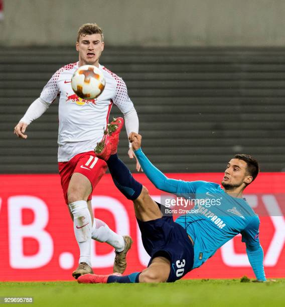Timo Werner of RB Leipzig is tackled by Emanuel Mammana of Zenit St Petersburg during UEFA Europa League Round of 16 match between RB Leipzig and...