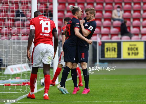 Timo Werner of RB Leipzig reacts as he celebrates scoring his sides fourth goal with team mate Kevin Kampl during the Bundesliga match between 1 FSV...