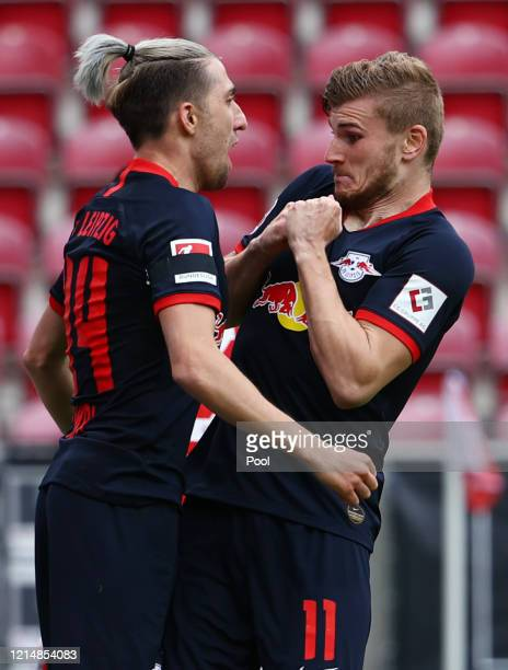 Timo Werner of RB Leipzig reacts as he celebrates scoring his sides fourth goal with team mate Kevin Kampl during the Bundesliga match between 1. FSV...