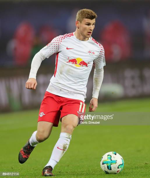 Timo Werner of RB Leipzig runs with the ball during the Bundesliga match between RB Leipzig and Hertha BSC at Red Bull Arena on December 17 2017 in...