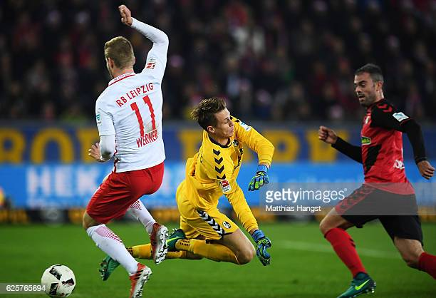 Timo Werner of RB Leipzig scores a goal past Alexander Schwolow of SC Freiburg during the Bundesliga match between SC Freiburg and RB Leipzig at...