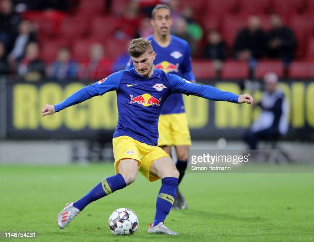 Timo Werner of RB Leipzig scores his sides third goal during the Bundesliga match between 1 FSV Mainz 05 and RB Leipzig at Opel Arena on May 03 2019...