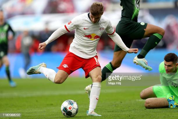 Timo Werner of RB Leipzig scores his team's first goal during the Bundesliga match between RB Leipzig and VfL Wolfsburg at Red Bull Arena on October...