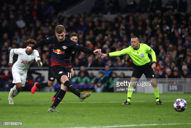 Timo Werner of RB Leipzig scores his team's first goal from the penalty spot during the UEFA Champions League round of 16 first leg match between...