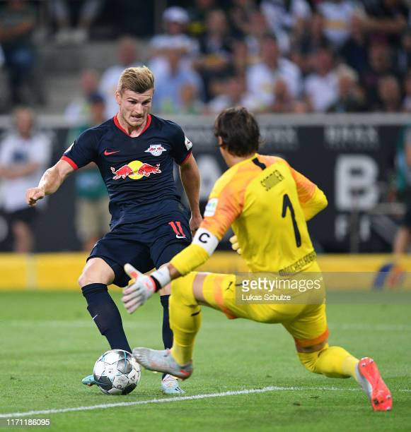 Timo Werner of RB Leipzig scores his team's first goal past Yann Sommer of Borussia Monchengladbach during the Bundesliga match between Borussia...