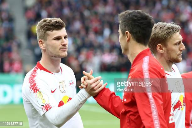Timo Werner of RB Leipzig shakes hands with Robert Lewandowski of Bayern Munich prior to the DFB Cup final between RB Leipzig and Bayern Muenchen at...