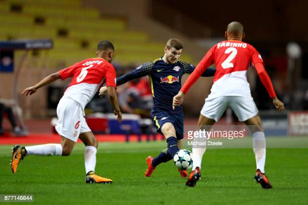 Timo Werner of RB Leipzig takes on Jorge and Fabinho of AS Monaco FC during the UEFA Champions League group G match between AS Monaco and RB Leipzig...