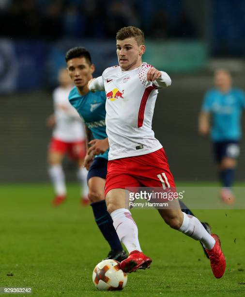 Timo Werner of RB Leipzig vies with Matas Kranevitter of FC Zenit Saint Petersburg during the UEFA Europa League Round of 16 match between RB Leipzig...