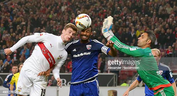 Timo Werner of Stuttgart battles for the ball with Marvin Matip of Ingolstadt and his keeper Ramazan Oezcan during the Bundesliga match between VfB...