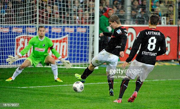 Timo Werner of Stuttgart scores his team's second goal past goalkeeper Oliver Baumann of Freiburgl during the Bundesliga match between SC Freiburg...