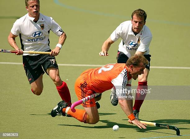 Timo Wess and Florian Keller of Germany battle for the ball with Jeroen Delmee of Netherlands during the friendly match between Germany and...