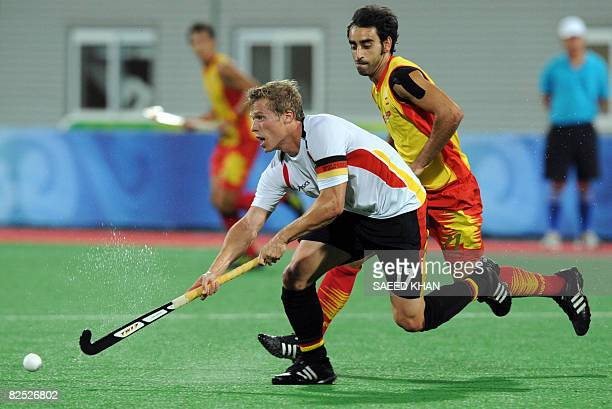 Timo Wess of Germany vies with Eduard Arbos of Spain in their men's final field hockey match at the Olympic Green Hockey Stadium during the 2008...