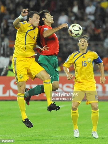 Timofei Kalachev of Belarus vies with Aleksandr Kucher of Ukraine during their World Cup 2010 group 6 qualifying football match in Minsk on September...