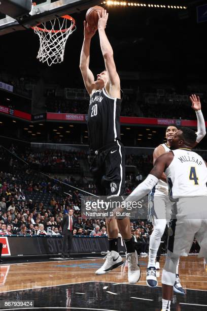 Timofey Mozgov of the Brooklyn Nets drives to the basket against the Denver Nuggets on October 29 2017 at Barclays Center in Brooklyn New York NOTE...