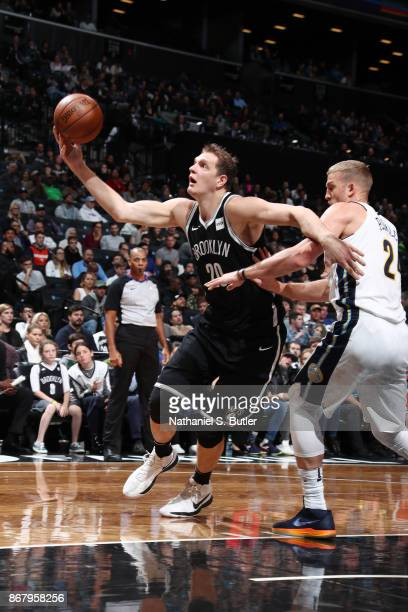 Timofey Mozgov of the Brooklyn Nets handles the ball against the Denver Nuggets on October 29 2017 at Barclays Center in Brooklyn New York NOTE TO...