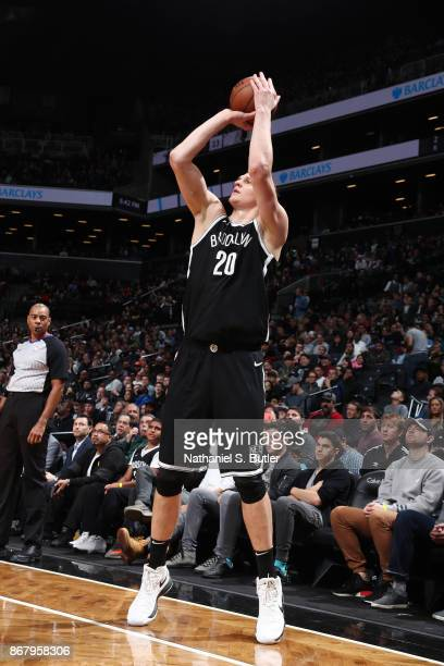Timofey Mozgov of the Brooklyn Nets shoots the ball against the Denver Nuggets on October 29 2017 at Barclays Center in Brooklyn New York NOTE TO...