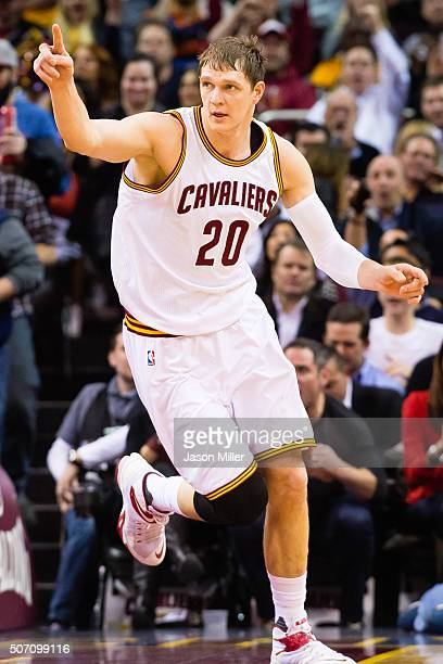 Timofey Mozgov of the Cleveland Cavaliers celebrates after scoring during the first half against the Los Angeles Clippers at Quicken Loans Arena on...