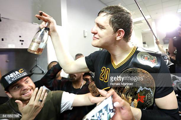Timofey Mozgov of the Cleveland Cavaliers celebrates in the locker room after defeating the Golden State Warriors 9389 in Game 7 to win the 2016 NBA...