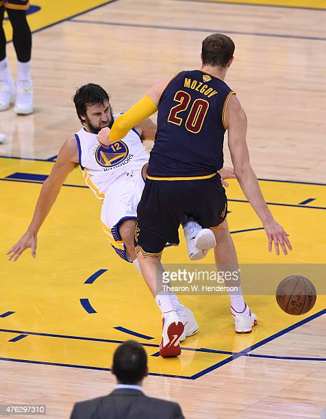 Timofey Mozgov of the Cleveland Cavaliers drives against Andrew Bogut of the Golden State Warriors in the first quarter during Game Two of the 2015...