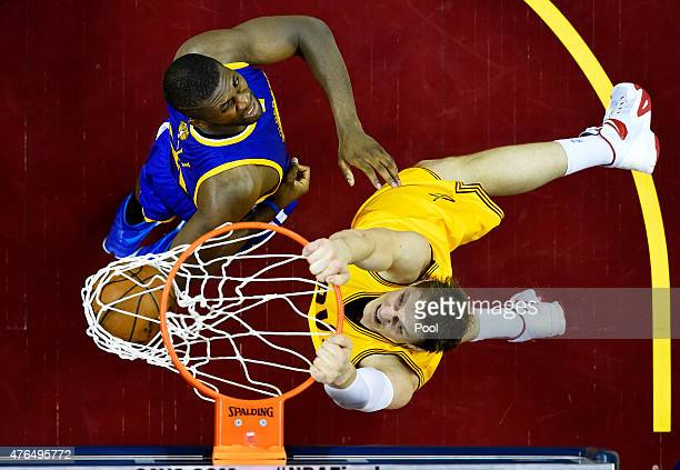 Timofey Mozgov of the Cleveland Cavaliers dunks against Festus Ezeli of the Golden State Warriors in the second half during Game Three of the 2015...