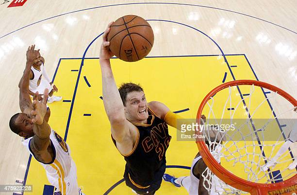 Timofey Mozgov of the Cleveland Cavaliers dunks against the Golden State Warriors in the first half during Game One of the 2015 NBA Finals at ORACLE...