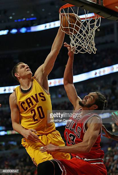 Timofey Mozgov of the Cleveland Cavaliers dunks on Joakim Noah of the Chicago Bulls at United Center on February 12 2015 in Chicago Illinois NOTE TO...
