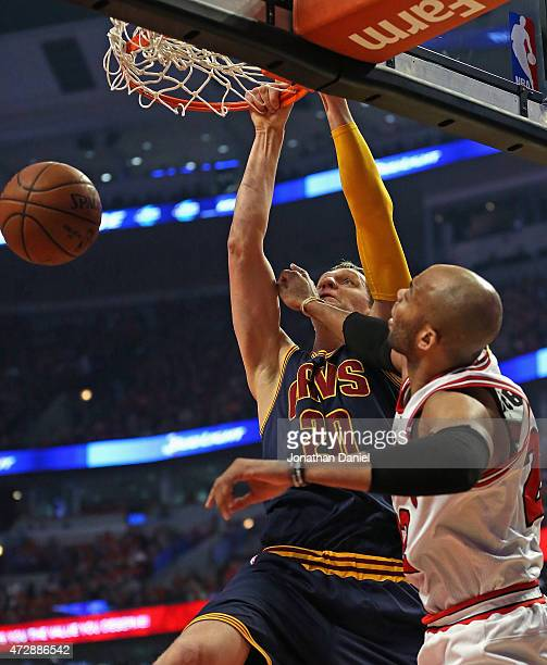 Timofey Mozgov of the Cleveland Cavaliers dunks over Taj Gibson of the Chicago Bulls in Game Four of the Eastern Conference Semifinals of the 2015...