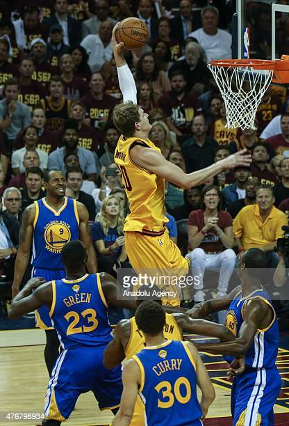 Timofey Mozgov of the Cleveland Cavaliers goes up against Stephen Curry Draymond Green Harrison Barnes and Andre Iguodala of the Golden State...