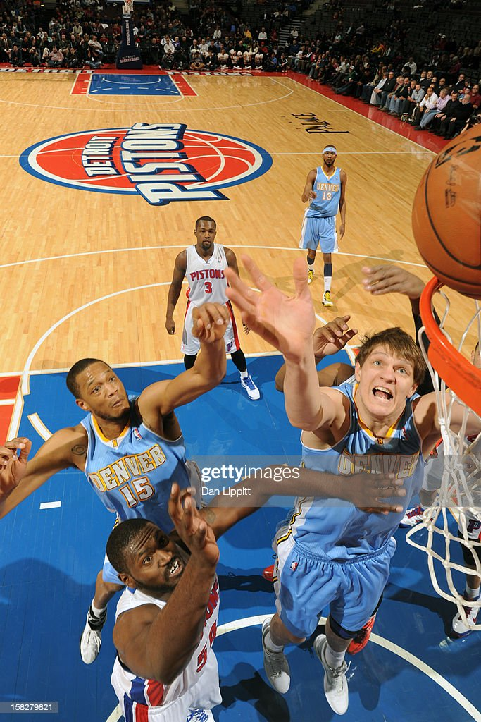 Timofey Mozgov #25 of the Denver Nuggets grabs the rebound against the Detroit Pistons on December 11, 2012 at The Palace of Auburn Hills in Auburn Hills, Michigan.