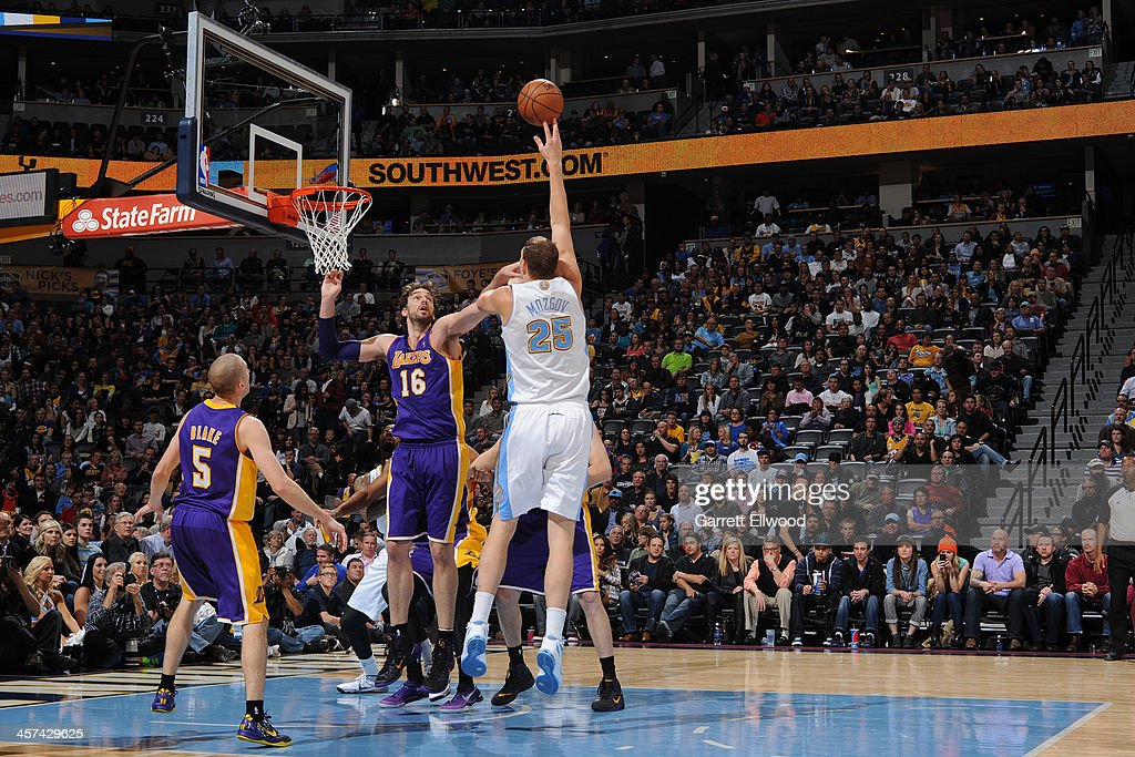 Timofey Mozgov #25 of the Denver Nuggets puts up a shot against the Los Angeles Lakers on November 13, 2013 at the Pepsi Center in Denver, Colorado.