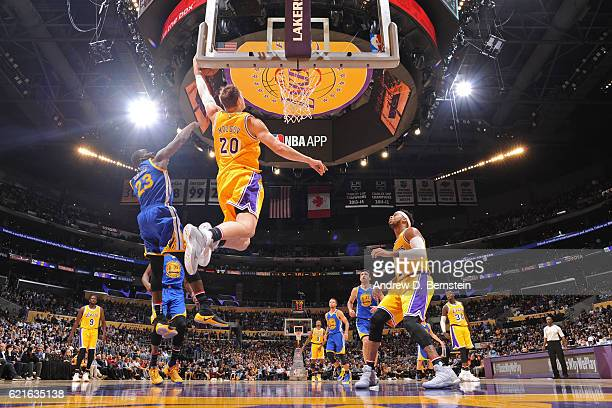 Timofey Mozgov of the Los Angeles Lakers dunks the ball against the Golden State Warriors on November 4 2016 at STAPLES Center in Los Angeles...