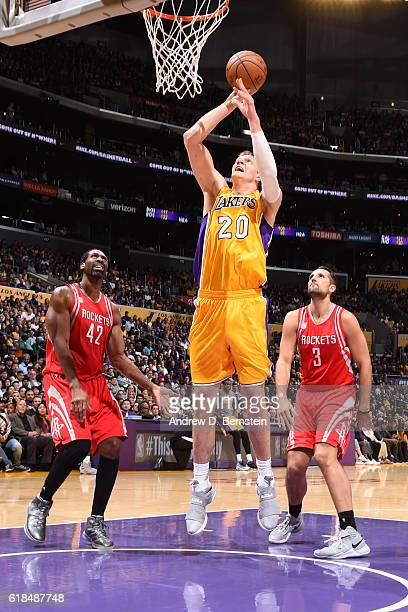 Timofey Mozgov of the Los Angeles Lakers shoots the ball against the Houston Rockets on October 26 2016 at STAPLES Center in Los Angeles California...