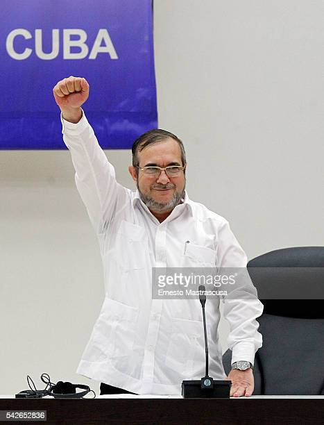 Timoleon Jimenez 'Timonchenko' raises his fist during a meeting to announce the Ceasefire Agreement between Colombian Government and the FARC rebels...
