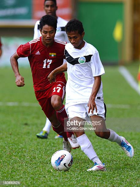 Timor Leste's Emanuel Antonio Cabral Abel fights for the ball with Myanmar's Min Mintun during a group B qualifying match at the 26th Southeast Asian...