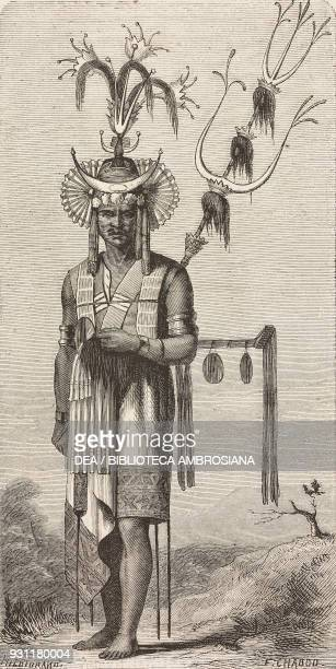 Timorese man wearing traditional costume drawing by E Chabot from The Malay Archipelago 18611862 by Alfred Russell Wallace or from Il Giro del mondo...