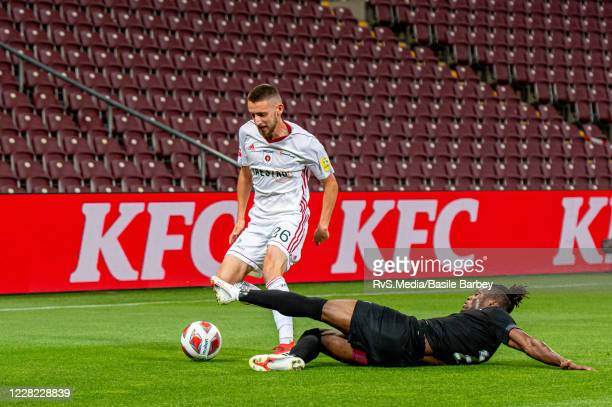 Timotej Mudry of MFK Ruzomberok battles for the ball with Arial Mendy of Servette FC in front of the empty stands during the UEFA Europa League...