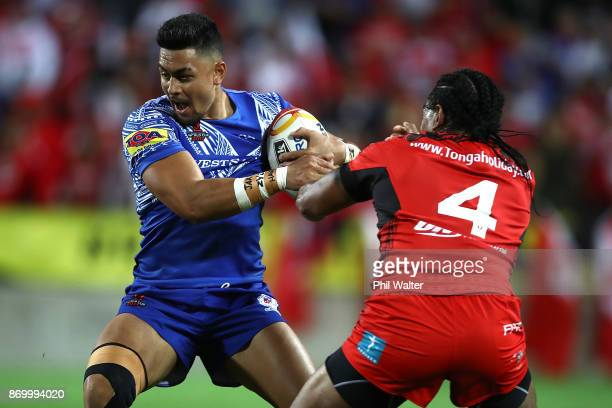 Timoteo Lafai of Samoa is tackled by Solomone Kata of Tonga during the 2017 Rugby League World Cup match between Samoa and Tonga at Waikato Stadium...