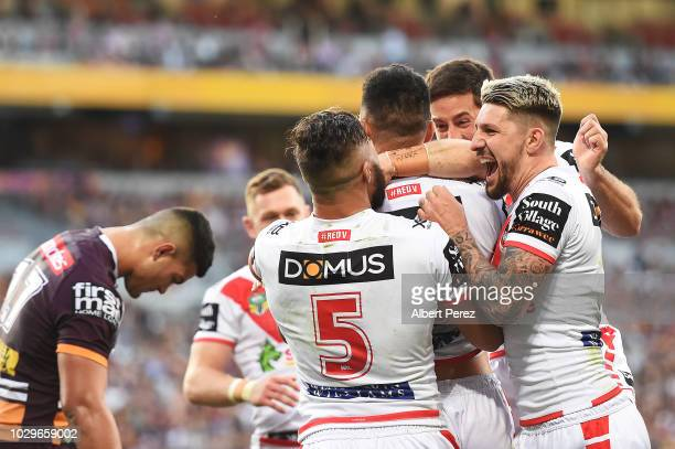 Timoteo Lafai of the Dragons is congratulated by team mates after scoring a try during the NRL Elimination Final match between the Brisbane Broncos...