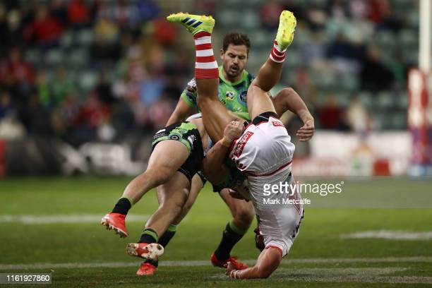 Timoteo Lafai of the Dragons Is tackled by Nick Cotric of the Raiders during the round 17 NRL match between the St George Illawarra Dragons and the...