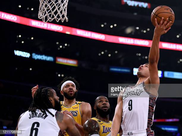 Timothe LuwawuCabarrot of the Brooklyn Nets attempts a layup in front of LeBron James and JaVale McGee of the Los Angeles Lakers with DeAndre Jordan...