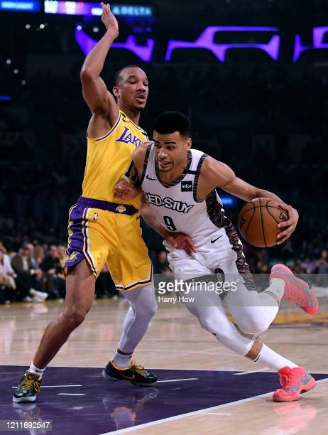 Timothe LuwawuCabarrot of the Brooklyn Nets dribbles as he is guarded by Avery Bradley of the Los Angeles Lakers during the first half at Staples...