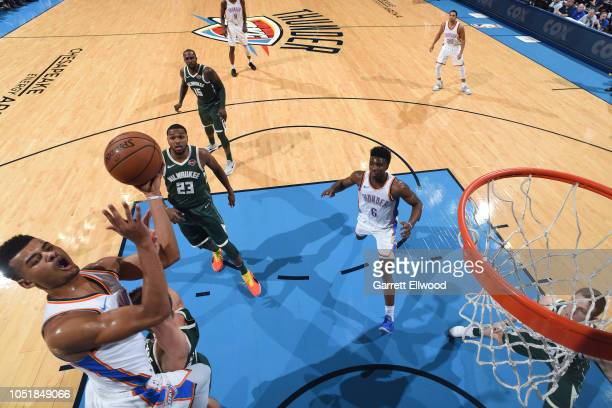 Timothe LuwawuCabarrot of the Oklahoma City Thunder shoots the ball against the Milwaukee Bucks during a preseason game on October 9 2018 at...