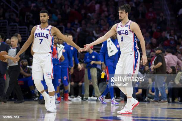 Timothe LuwawuCabarrot of the Philadelphia 76ers celebrates with Dario Saric against the Detroit Pistons at the Wells Fargo Center on December 2 2017...